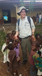 Rev. Woody Eddins with children in front of the school